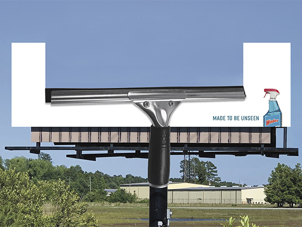 A billboard advertising a window cleaning prodcut