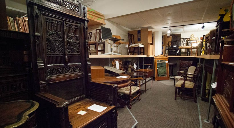A room full of antique furniture