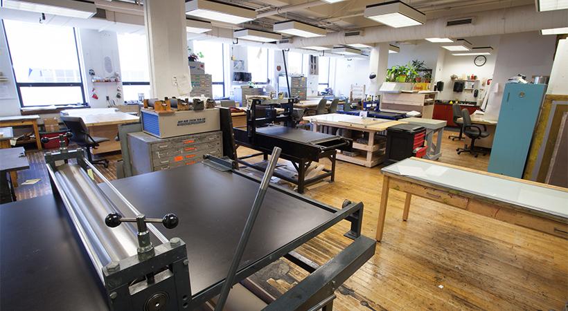 Empty room full of printmaking equipment