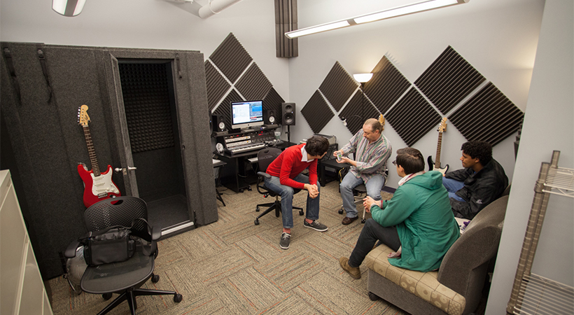 Recording studio where instructor is showing students techniques