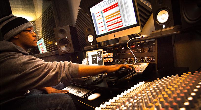 Man recording audio on a computer