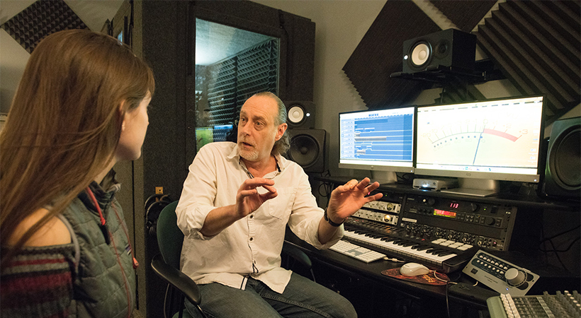 Recording studio where instructor is showing student techniques