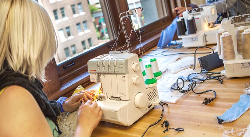 A woman operating a sewing machine