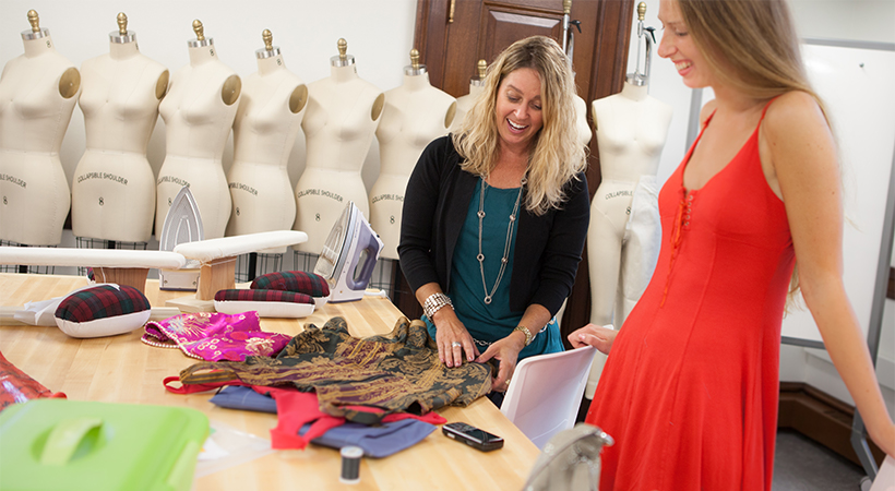 Two women examining fabric samples