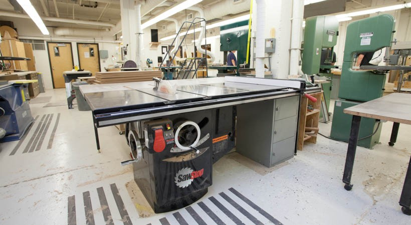A large room filled with woodworking equipment