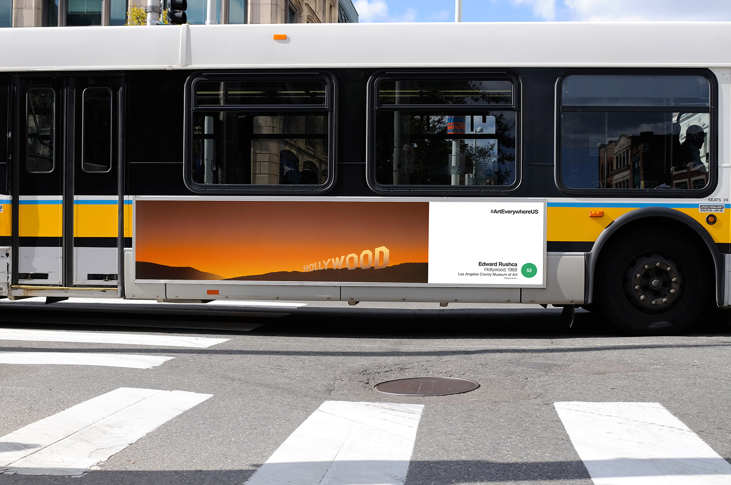 """Edward Rushca's """"Hollywood"""" on the side of a bus (image courtesy of Extra Credit Projects)"""
