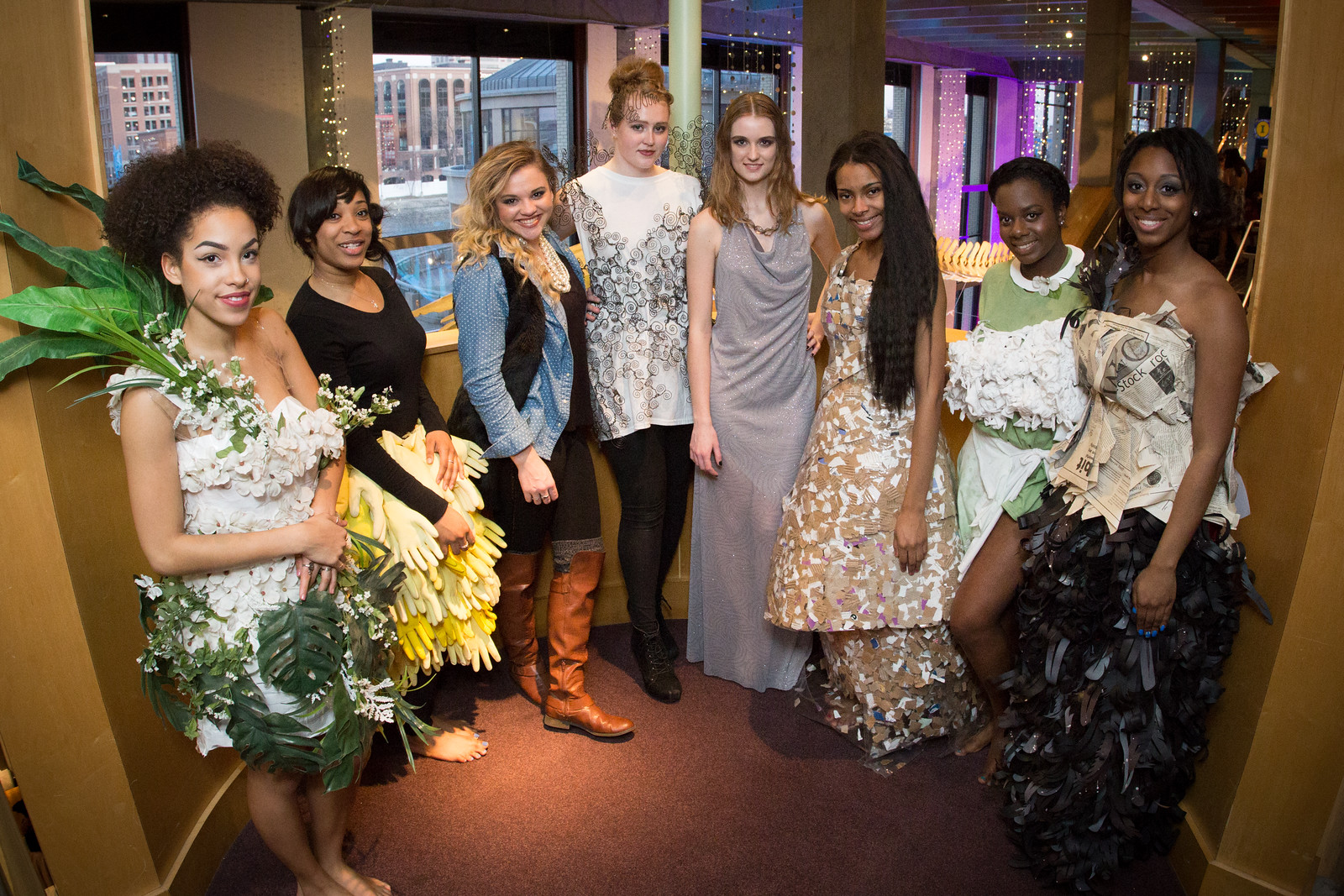 A group of models showing off student-designed garments