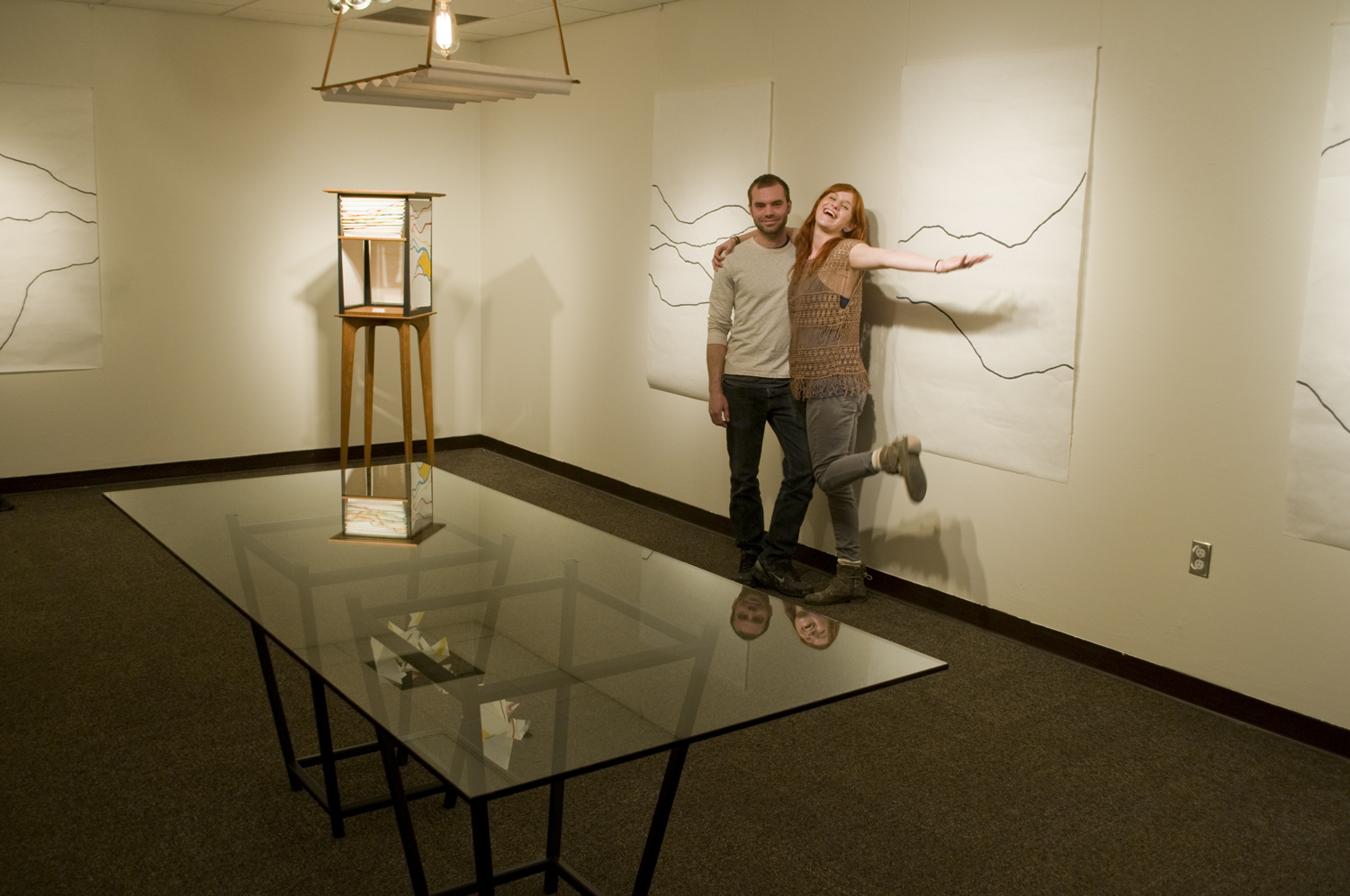 Evan Fay and Megan Armstrong pose next to their exhibition