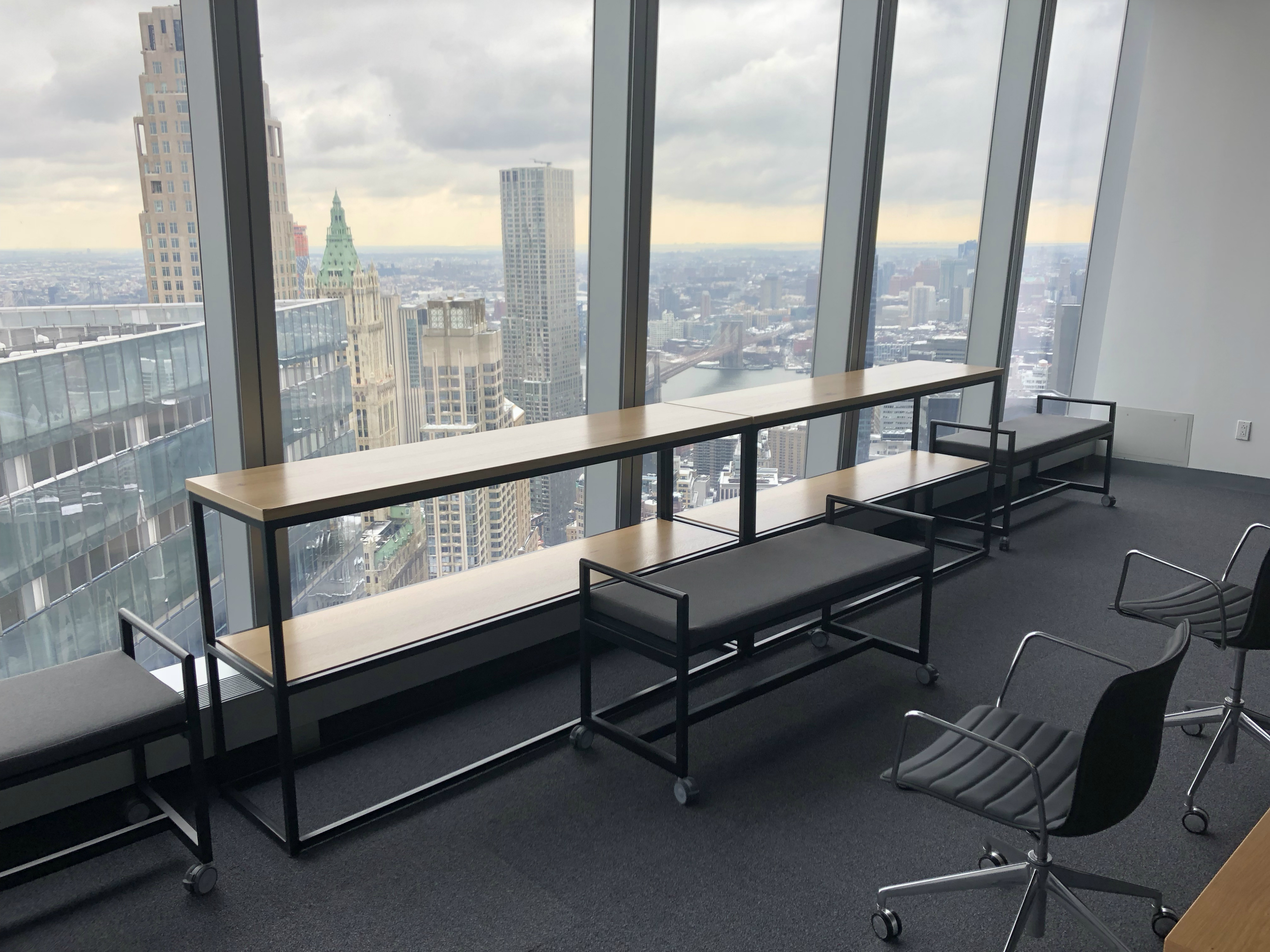 Table by window of a tall office building