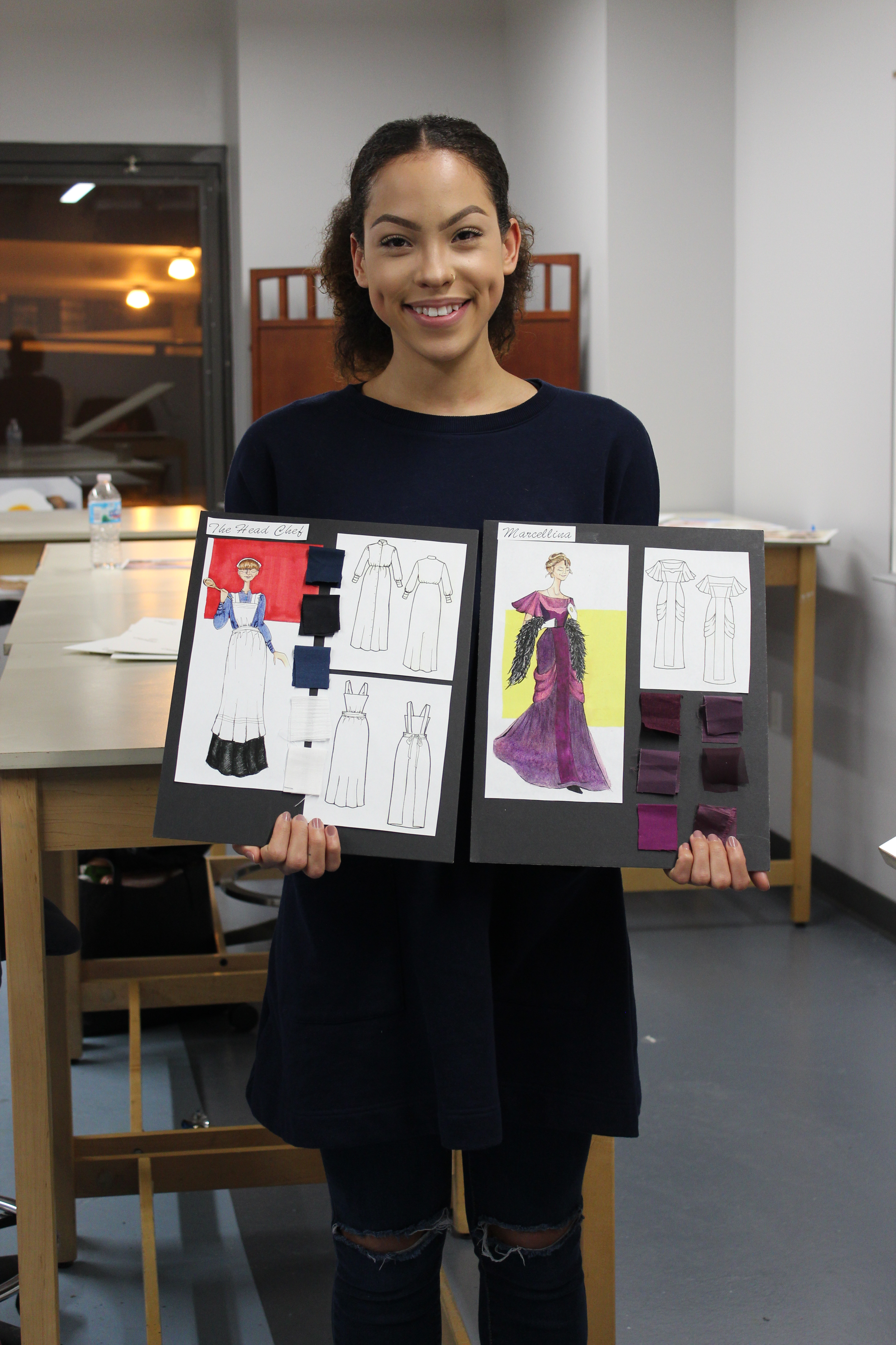 Fashion Studies student holding illustration