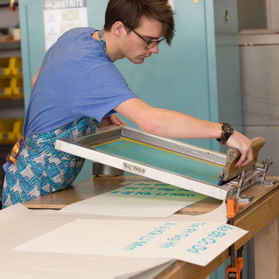 Nick Tisch using printmaking equipment