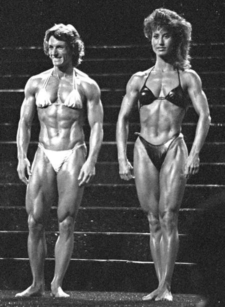 two female body builders standing on a stage