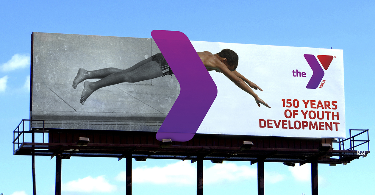 Billboard of a swimmer on the side of a building