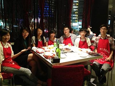 student interns at dinner