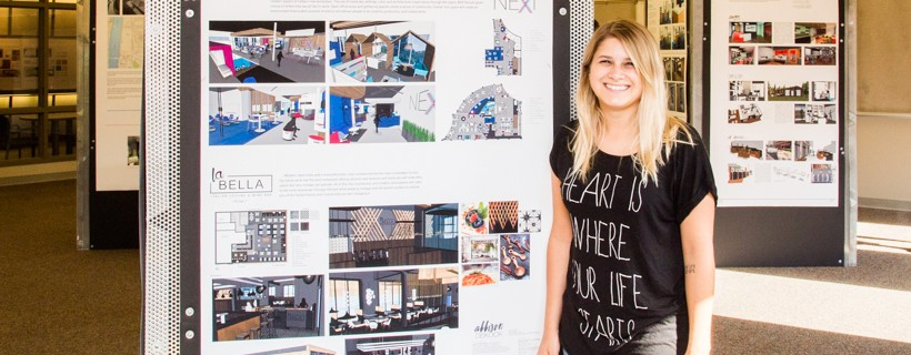 Artist standing next to their work that features several concepts for assorted room designs