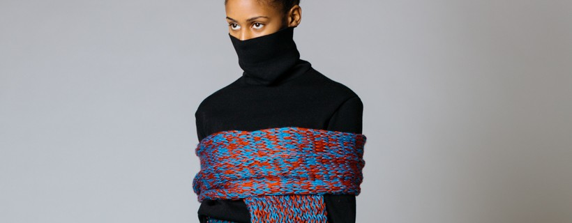 model wearing Outfit with black turtleneck and blue skirt