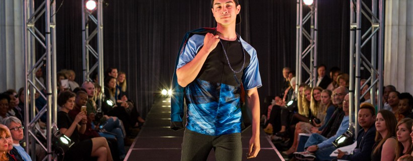 model wearing Outfit featuring shiny blue top and black pants