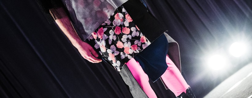 model wearing Outfit with black boots, pink pants and floral patterned shirt