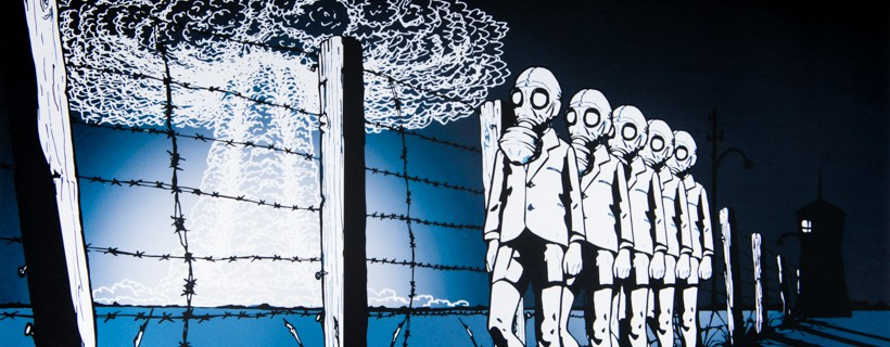 Figures in gas masks line up next to barbed wire fence while mushroom cloud emerges in the distance