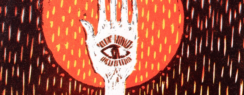 woodcut print of hand with eye in orange circle