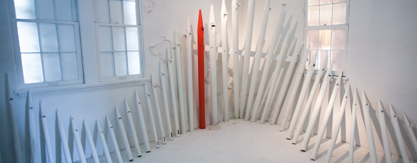 installation of organ pipes against wall of room