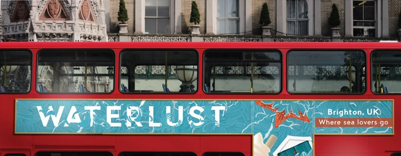 Subtle turquoise advertisement on side of red double decker bus with white car in foreground