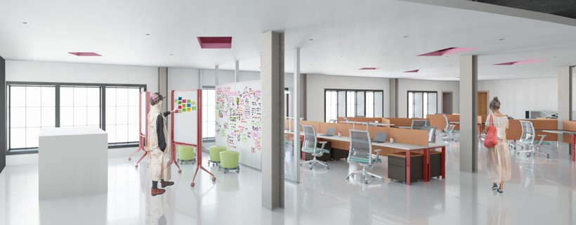 Wide angle of office space with open desks and a meeting area