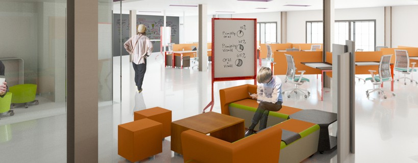 Seating area with orange stools and a mobile presentation board in middle of office space