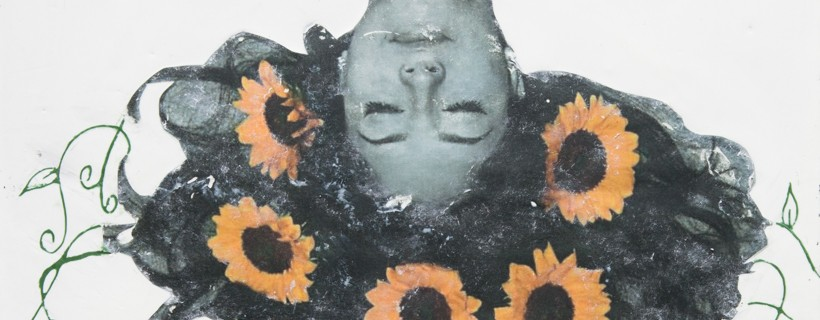 Upside down depiction of a person with sunflowers in their hair