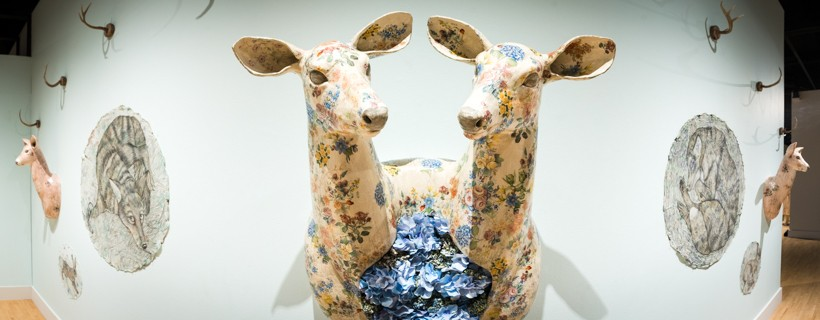 Sculpture of two headed deer with white skin and a floral pattern