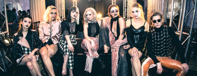 Several Fashion Models Sitting On Runway