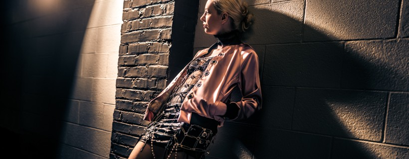 Pink jacket with black leather skirt and metal chain overlay