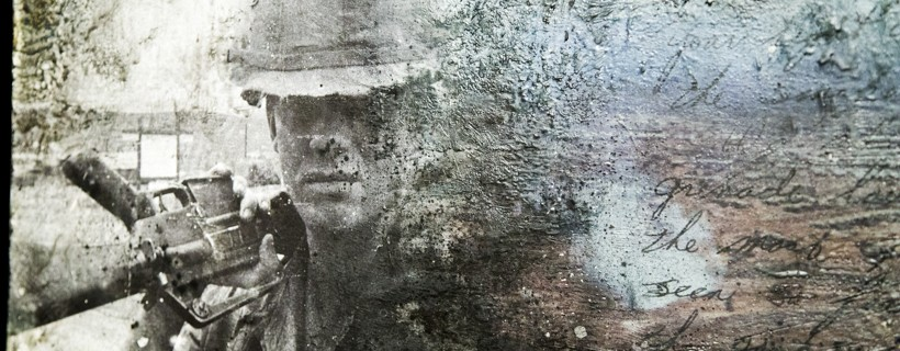 Very distressed photo of a soldier with a gun slung over their shoulder