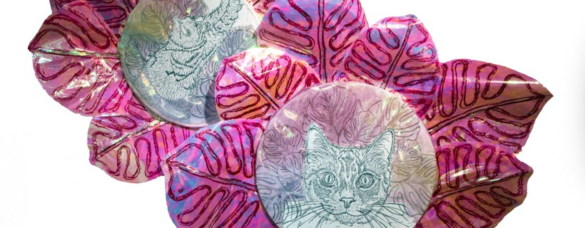 flowers with etchings of cats in the center