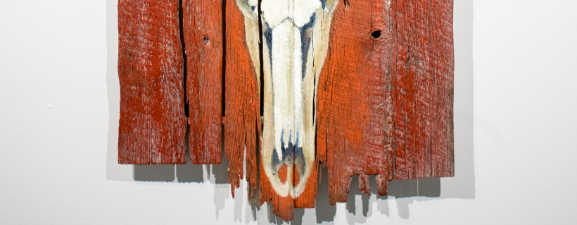 animal skull painted on reclaimed wood with text saying trophy quality