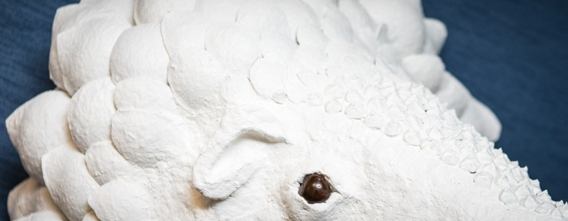 Sculpture of the head of a white animal with a white snout