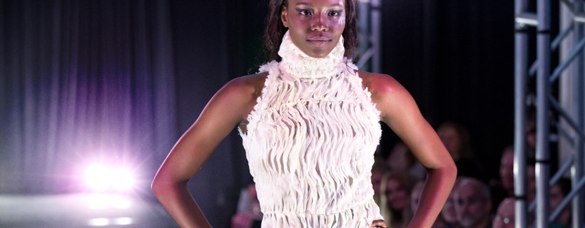 Model Wearing White Suit With Wavy Inlay