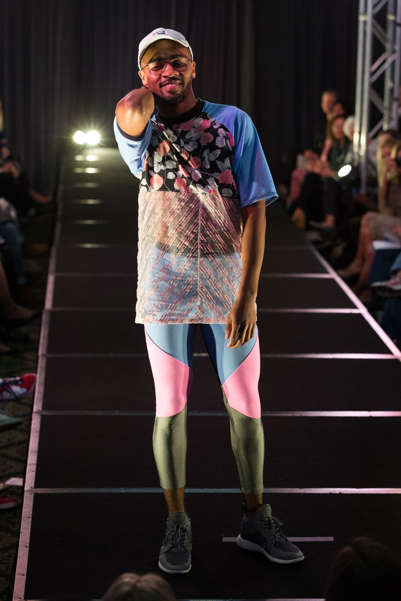 Model Wearing Outfit With Blue And Pink Themes And A Floral Pattern Top