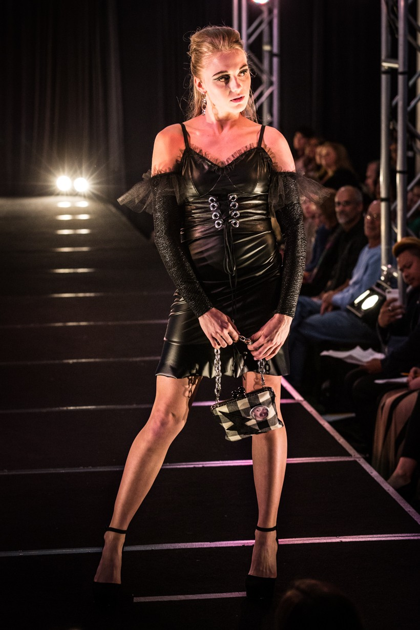 Model Wearing Black Leather Dress With Sleeves