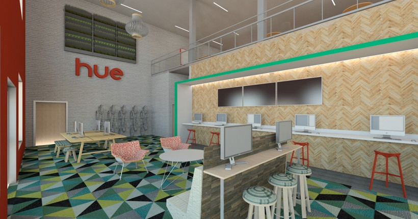 Digital Rendering Of Room With Desks Computers On Them And Green Geometric Design Carpet