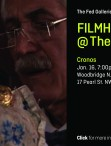 screen shot from film Cronos. Older gentleman holding golden object. Young child observing