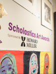 gallery wall with student artwork and text