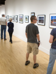 visitors in the galleries looking at artwork during Festival 2018