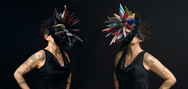 Object of Mourning by Renée Zettle-Sterling. Masks with decorative fabric forms that hang outward. Photo by Bree Mullen