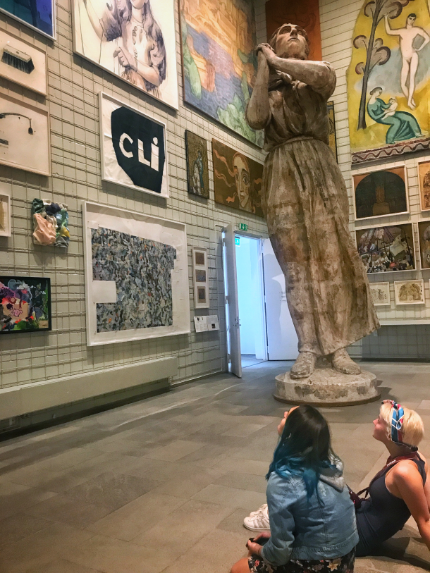 Students from the Summer in Sweden program viewing paintings, sculpture, and other artwork