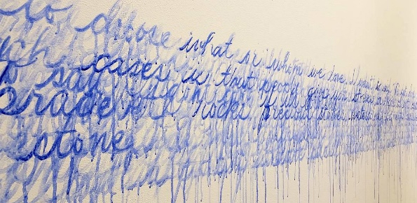 blue blurred painted cursive text on the wall