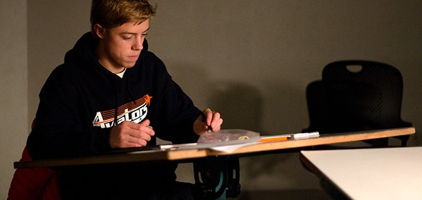 student working at a desk