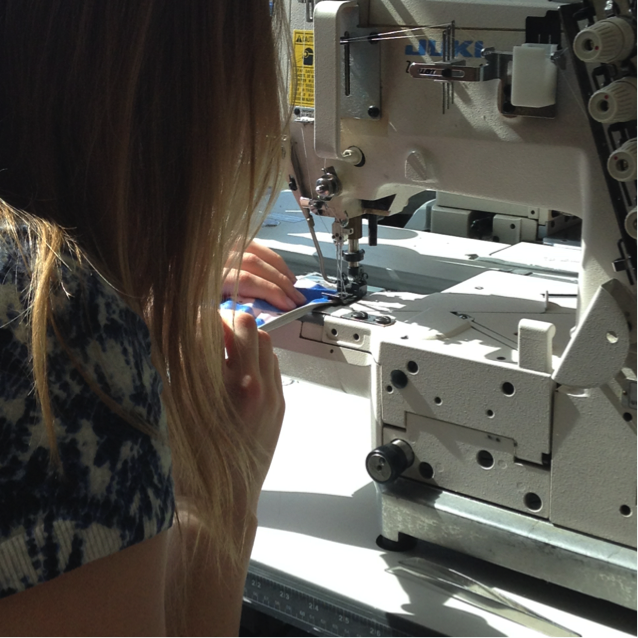 student Emily Prchlik top stitching on her leotard prototype.