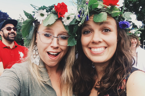 students wearing flowers at the Midsummer festivities