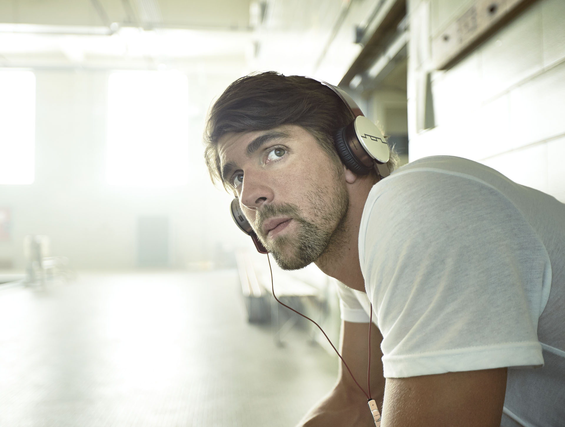 Man staring at the camera wearing headphones